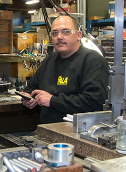 person in safety goggles with manufacturing technology equipment