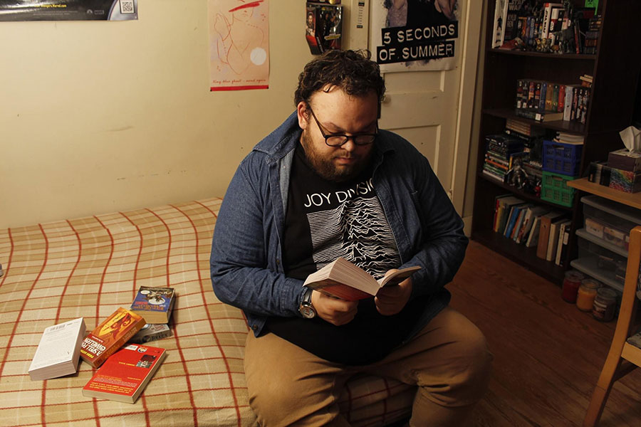 photo of person reading on bed