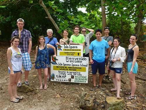 group of students and professors with Iguana Island sign in panama