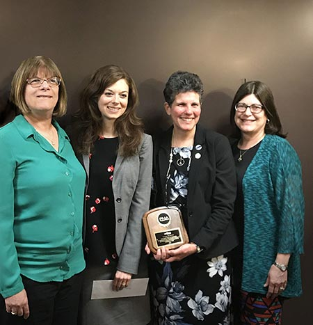 Four nursing instructors with award