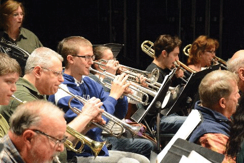 musicians playing instruments in orchestra