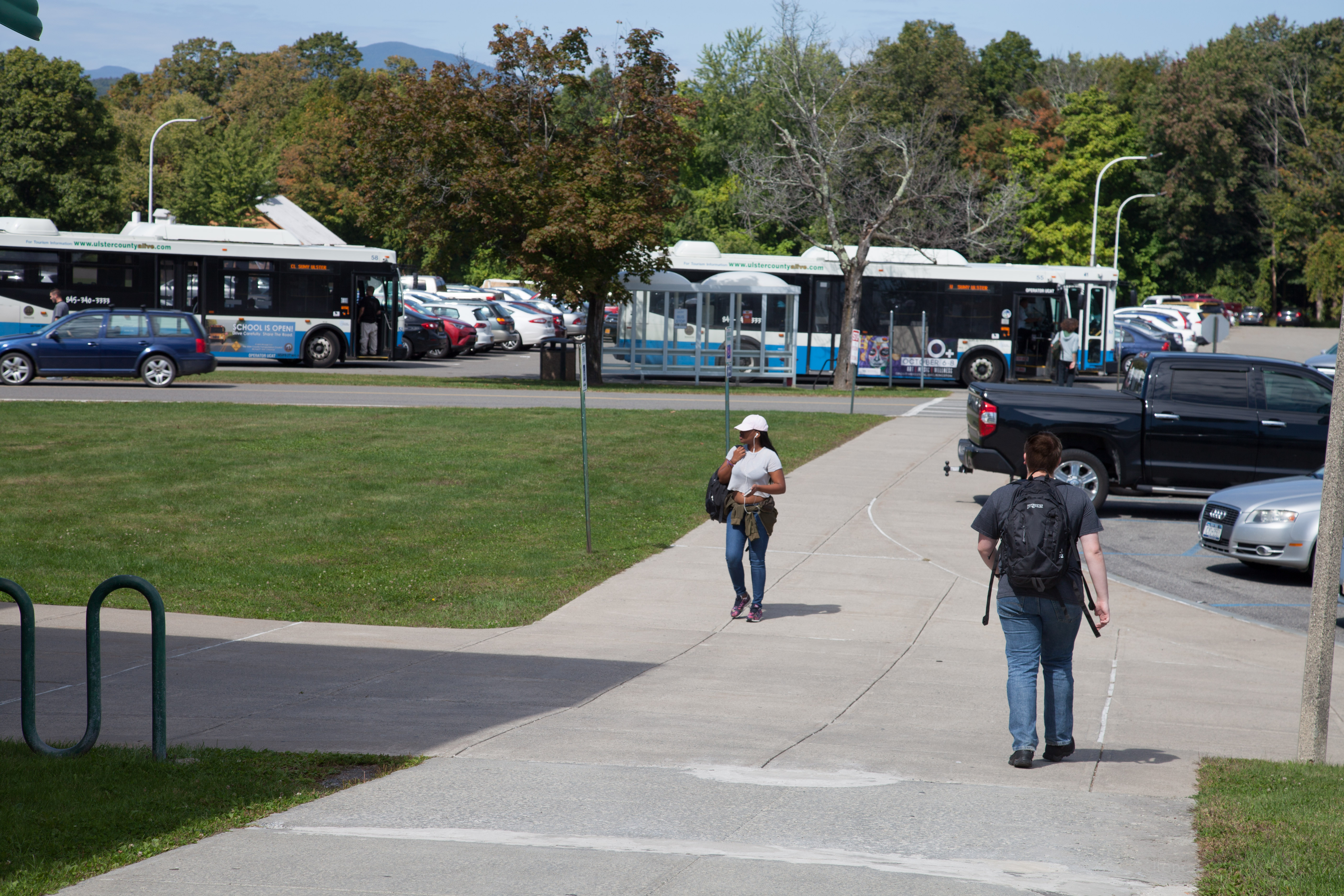 campus view with students and busses