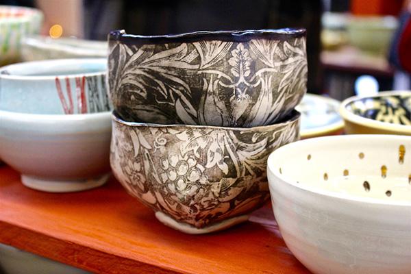 stacks of handmade bowls at chili bowl fundraiser