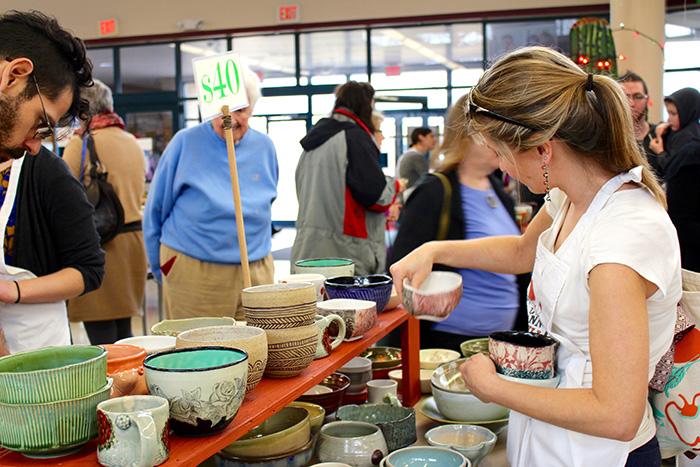 shoppers at chili bowl sale looking at handmade bowls