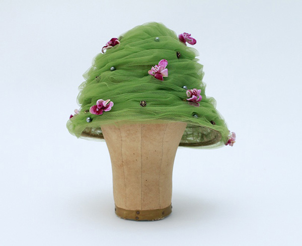 student artwork fashion green hat with pink flowers