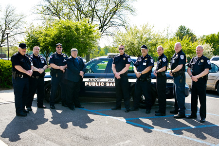 SUNY Ulster Public Safety & Security officers posing in front of police cruiser