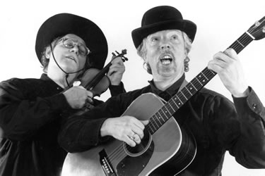 balck and white photo of Horowitz and Malkine singing and playing instruments
