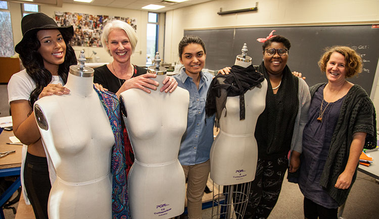 Fashion students  and faculty pose with mannequins