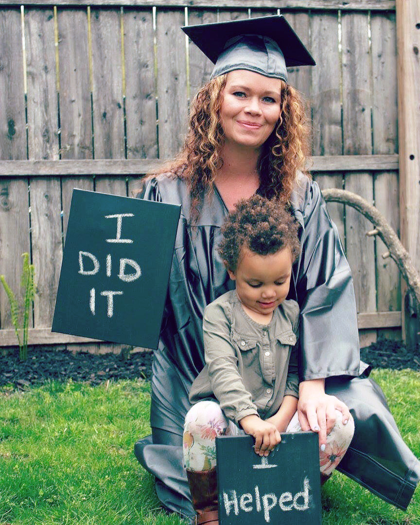 I Helped - sign with child and adult student in graduation garb