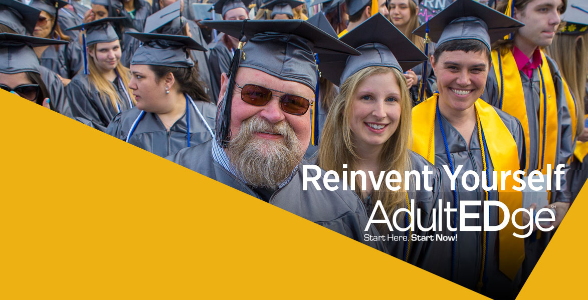 Smiling Adult Students in cap and gown