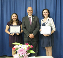 Chamber Scholarship Presentation with two students holding awardsand older man
